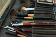 The brush and the shade of specialist make-up Stock Photo