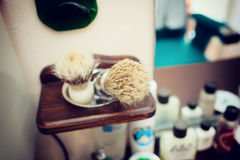 Brush shaving set in barber shop Stock Photography