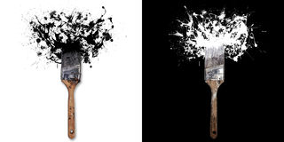 Brush with splashes of white/black ink. On white/black background Royalty Free Stock Image