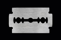 Brush Steel Texture Razor Blade. On black background Royalty Free Stock Photo