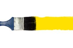 Brush and stroke. Brush and yellow paint stroke Royalty Free Stock Photo