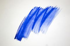 Brush stroke with gouache in blue color. On a white sheet of paper royalty free stock photos
