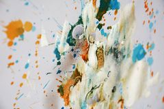 Silver white orange watercolor paint brush strokes, hues, spots. Brush strokes and hand made muddy design with gray, blue, gold, white, silvery, violet hues and royalty free stock image