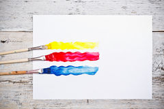 Brush strokes with paint brushes Stock Photo