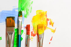 Brush strokes and paint brushes on white Royalty Free Stock Photography