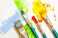 Brush strokes and paint brushes on white Stock Images