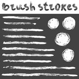 Brush strokes set. Vector hand drawn set of grunge brush strokes and circles Stock Images