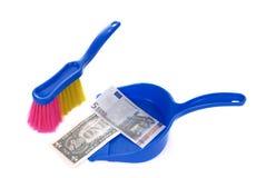 Brush sweeping euro and dollar banknote Royalty Free Stock Image