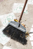 Brush sweeps trash Stock Photo