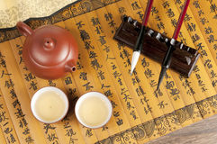 Brush and teapot Royalty Free Stock Images
