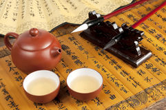 Brush and teapot Royalty Free Stock Photography