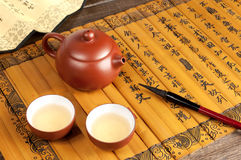 Brush and teapot Stock Photography