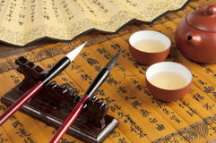 Brush and teapot Royalty Free Stock Image