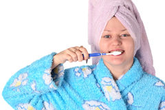 Brush a teeth. Girl brush her teeth on white Stock Photo