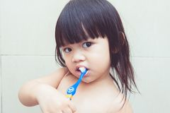Brush their teeth. Little girls are learning to brush their teeth Stock Photography