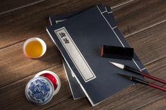 Brush and thread-bound book Royalty Free Stock Image