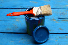 Brush  on tin can. Brush painting on tin can of blue paint Royalty Free Stock Images