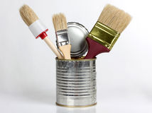 Brush in tins Stock Photos