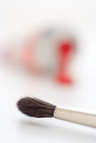 Brush tip. Close-up of artistic brush tip with fuzzy paint tube on the background royalty free stock images