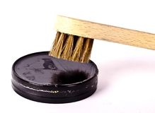 A brush about to apply shoe polish. On white background Royalty Free Stock Image