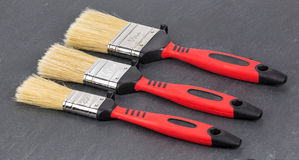 Brush to paint on a gray background Royalty Free Stock Images