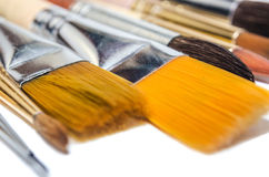 Brush to paint with watercolors isolated on white background Royalty Free Stock Image