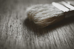Brush to paint on wooden background Royalty Free Stock Photos