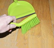 Brush to sweep the floor to remove. The dust in the dustpan Royalty Free Stock Photography