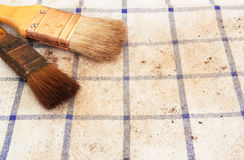 Brush tool. Metal brush tool on tablecloth Royalty Free Stock Photography