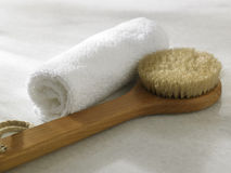Brush and towel Stock Images