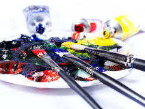 Brush with tubes of paint. And palette Stock Photo