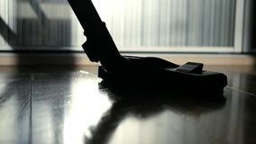 Brush vacuum cleaner walks the floor, removes dirt and dust. slowmotion.  stock video