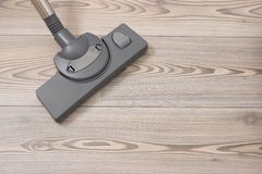 Brush of the vacuum cleaner on a wooden floor. royalty free stock photography