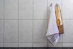 Brush washcloth and towel hanging on a hook in the bathroom, on Stock Photos