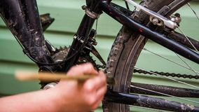 The brush washes the bicycle frame. Hand using a brush clears the bicycle frame from dirt stock footage