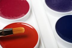 Brush and water colour paints Stock Photography