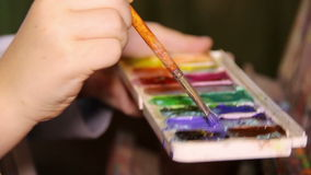 Brush in watercolor stock footage