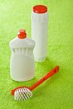 Brush and white bottles on green background Royalty Free Stock Image