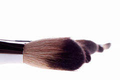Brush white makeup Stock Images