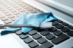 Brush and Wipes clean put on keyboard Notebook Stock Photo