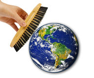 Brush in woman hand cleaning earth Royalty Free Stock Photo