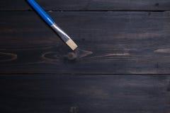 Brush on wood Stock Photo