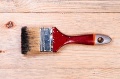 Brush on wooden background. Stock Photos
