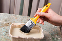 Brush in worker hand Royalty Free Stock Image