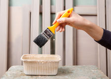 Brush in worker hand Stock Image