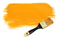 Brush and yellow paint Stock Photography
