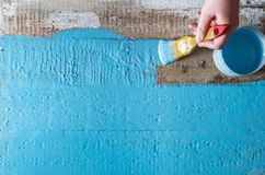 Brush yellow paint a rough wood surface blue color. Creative abstract screensaver background Stock Image