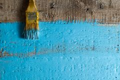 Brush yellow paint a rough wood surface blue color. Creative abstract screensaver background Royalty Free Stock Photography
