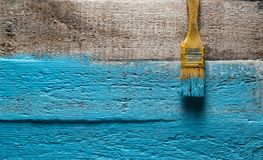 Brush yellow paint a rough wood surface blue color. Creative abstract screensaver background Stock Photo