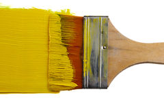 Brush and yellow paint stroke. Isolated on white background stock images